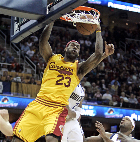 lebron james dunking on people. LeBron James, front, dunks